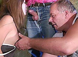 Sex-addicted nubile cutie taking five old cocks in her greedy cum-starved mouth and getting gangbanged outdoors